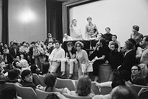 Events of May-June 1968. Etats Généraux du Cinéma at the Cannes Film Festival. Henri Chapier at the gallery. Front, from left to right: Roger Hanin, Nedjar and Nelly Kaplan (sunglasses). On the left, profile, Claude Lelouch and on the right, José-Maria Flotats, Spanish actor. Cannes (France), 1968. Photograph by Janine Niepce (1921-2007). © Janine Niepce/Roger-Viollet