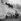 Etudiants du collège d'Eton regardant d'autres étudiants jouant à l'Eton Wall Game. Windsor (Angleterre), 29 novembre 1969. © PA Archive/Roger-Viollet