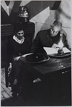 Jean Renoir (1894-1979), French director, with his wife, 1954. Photograph by Jean Marquis (1926-2019). Bibliothèque historique de la Ville de Paris. © Jean Marquis / BHVP / Roger-Viollet