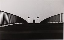 Man walking on the former footbridge of the canal de l'Ourcq, passage de Flandre. Paris (XIXth arrondissement), circa 1968. Photograph by Léon Claude Vénézia (1941-2013). © Léon Claude Vénézia/Roger-Viollet
