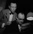 """Louis Jouvet (1887-1951) and Pierre Renoir (1885-1952), French actors, during a rehearsal of """"L'Impromptu de Paris"""", play by Jean Giraudoux. Paris, Théâtre de l'Athénée, December 1937. © Gaston Paris / Roger-Viollet"""