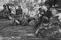 Cambodian War. Woman with her child near Cambodian soldiers, 1975. © Françoise Demulder / Roger-Viollet