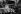 L'annexion des Sudètes. Vote supplémentaire au palais du Reichstag (parlement allemand); Discours d'Hitler dans le hall d'exposition de Reichenberg. Dans la tribune d'Honneur, à gauche : Gauleiter Hans Krebs et Heinrich Hoffmann, reporter photographique pour le Reich (respectivement 2ème et 3ème en partant de la gauche). A droite de l'estrade : Arthur Seyss-Inquart, gouverneur du Reich et le directeur du groupe Porsche. 2 décembre 1938. © Ullstein Bild/Roger-Viollet