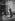 Après la crue de la Seine. Lessivage d'une devanture. Paris, quai des Grands Augustins (VIème arr.), 1910. © Maurice-Louis Branger/Roger-Viollet