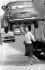 """Lindsay Wagner (née en 1949), actrice américaine, faisant semblant de porter une Mini à une main devant les les studios de télévision de Euston Road, lors du tournage de la série """"Super Jaimie"""" d'après le roman """"Cyborg"""" de Martin Caidin. Londres (Angleterre), 6 juin 1976. © PA Archive/Roger-Viollet"""