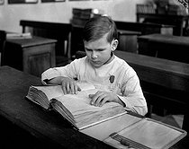 Young blind boy learning to read in Braille. France, 1942. © LAPI/Roger-Viollet
