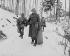 Guerre 1939-1945. Trois hommes de la compagnie B du  101ème « Engineer » bataillon américain sortant de leur cantonnement lors de la bataille des Ardennes. Wiltz (Luxembourg), 14 janvier 1945. © TopFoto / Roger-Viollet
