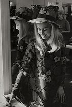 Catherine Deneuve (born in 1943), French actress, at Yves Saint-Laurent's couture house. Paris, 1967.  © Jean Mounicq / Roger-Viollet