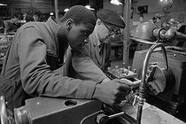 Professional training workshop. Student learning how to use a lathe with his teacher. Issy-les-Moulineaux (France), October 1971. Photograph by Léon Claude Vénézia (1941-2013). © Léon Claude Vénézia/Roger-Viollet