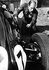 Grand Prix d'Europe au Nürburgring. Stirling Moss (né en 1929), coureur automobile britannique, vérifiant sa voiture de course avant le départ. Allemagne, août 1961. © Ullstein Bild/Roger-Viollet