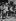 Guerre 1939-1945. Front de Normandie. Soldats américains en compagnie d'une petite fille française dans une ville libérée de Normandie. France, 27 juin 1944. © Collection Roger-Viollet / Roger-Viollet