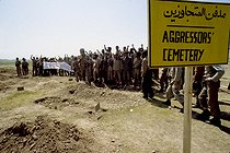 """Iran-Iraq War. Ahvaz front. """"Aggressors' Cemetery"""", Iranian army in an Iraqi cemetery. April 1982.$$$ © Françoise Demulder / Roger-Viollet"""