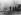 Guerre 1939-1945. Bataille des Ardennes. Panzergrenadiers, soldats de l'armée allemande, accompagnant des chars dans un village, 17-20 décembre 1944. © Ullstein Bild / Roger-Viollet