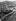Annexion des Sudètes. La Theaterplatz à Karlovy Vary (République Tchèque). Hitler accompagné des formations d'honneur de la Wehrmacht. Au fond : le rocher de Hirschsprung, le 4 octobre 1938. © Ullstein Bild/Roger-Viollet