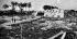Guerre 1939-1945. Bâtiment de contrôle et zone de lancement de missiles camouflés. Parmi les arbres on aperçoit la rampe de lancement. Normandie (France), juillet 1944. © TopFoto / Roger-Viollet