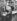 """Willy Guggenheim, dit Varlin (1900-1977), peintre et graveur suisse, tenant un exemplaire du journal suisse """"Neue Zürcher Zeitung"""", annonçant l'Anchluss, invasion de l'Autriche par Hitler. Zurich (Suisse), 1938. Photographie de Theo Frey (1908-1997). © Theo Frey / Fotostiftung Schweiz / KEYSTONE Suisse / Roger-Viollet"""