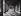 Enfant courant et ancienne blanchisserie sous les arcades de la place des Vosges. Paris (IVème arr.), 1970. Photographie de Léon Claude Vénézia (1941-2013). © Léon Claude Vénézia/Roger-Viollet
