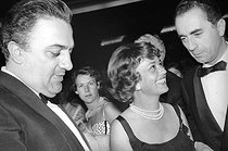 Federico Fellini (1920-1993), Italian writer and director, Jeanne Moreau (1928-2017), French actress, and Michelangelo Antonioni (1912-2007), Italian scriptwriter and director. Cannes Film Festival, 1960. © Noa / Roger-Viollet