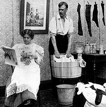 Woman of the 20th century: laundry day. Humorous photograph published in 1901. © Roger-Viollet