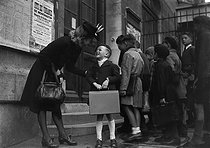 First day of school, a mother giving last advices to her son. Paris, XVIIIth arrondissement, October 1943. © LAPI/Roger-Viollet