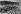 Pavage des rues de Paris. La taille des pavés de bois, vers 1920.     © Jacques Boyer/Roger-Viollet