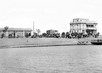 El Kantara (Suez Canal, Egypt). A caravan getting ready to cross the canal. 1912. © Jacques Boyer/Roger-Viollet