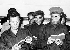 """Représentants des partis de gauche lisant des passages du """"Petit Livre rouge"""" du président communiste Mao Zedong en signe de protestation devant la maison du gouvernement. Macao (Chine), 7 décembre 1966. © TopFoto/Roger-Viollet"""