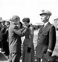 Pierre Montel (1896-1967), French Secretary of State for Air, presenting the Legion of Honour to Jacqueline Auriol (1917-2000), French aviatrix. Brétigny-sur-Orge (France), on September 20, 1952.  © Roger-Viollet