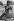 Cambodian War. Child picking up shell cases on road number 4. Cambodia, 1975. © Françoise Demulder / Roger-Viollet