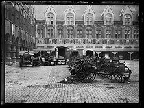 "World War One. Trucks and cannons left by the German soldiers during their retreat, in the courtyard of the Liège law courts (Belgium), on November 24, 1918. Photograph published in the newspaper ""Excelsior"", on November 28, 1918. © Excelsior – L'Equipe/Roger-Viollet"
