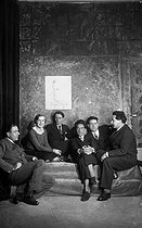 The group des Six: from left to right, Francis Poulenc, Germaine Tailleferre, Louis Durey, Jean Cocteau, French writer (who joined the composers group), Georges Auric (absent, drawn by Cocteau), Darius Milhaud and Arthur Honegger. On 1931. © Studio Lipnitzki/Roger-Viollet