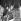 John Lennon avec son fils, Yoko Ono, et Eric Clapton lors d'une répétition pour le Rock And Roll Circus Show des Rolling Stones. Wembley, le 10 décembre 1968   © TopFoto / Roger-Viollet