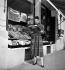 Paulette Caillaux, French model, wearing a tartan dress designed by Pierre Balmain. Paris, on August 27, 1952.  © Roger Berson/Roger-Viollet