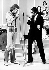 Johnny Hallyday (1943-2017), acteur et chanteur français, et Alberto Lupo (1924-1984), acteur italien, lors d''une émission télévisée. 1965-1975. © Alinari/Roger-Viollet