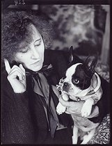 """Colette with a dog"", photograph by Walter Limot (1902-1984). Paris, musée Carnavalet. © Walter Limot / Musée Carnavalet / Roger-Viollet"