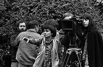 "Agnès Varda (1928-2019), French director, during the filming of ""L'Une chante, l'autre pas"". Behind the camera : Anouch Aviv. France, 1976. © Roger-Viollet"