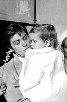 Alain Delon (born in 1935), French actor, with his son Anthony for his christening, on May 1st, 1966. Photograph by Georges Kelaïditès (1932-2015). © Georges Kelaïditès / Roger-Viollet