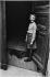 Jeune fille masquée et son chien, boulevard Beaumarchais. Paris (IIIème arr.), années 1970. Photographie de Léon Claude Vénézia (1941-2013). © Léon Claude Vénézia/Roger-Viollet