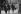 Guerre 1939-1945. L'amiral François Darlan (fumant la pipe, à gauche) et Jacques Benoist-Méchin (à sa gauche) arrivant au Conseil des ministres. Vichy, mai 1941. © LAPI/Roger-Viollet