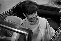 Audrey Hepburn (1929-1993), British actress, at the wheel of a Fiat convertible car in Paris. © Noa / Roger-Viollet