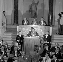 Salvador Dalí, Spanish painter, making a speech for his nomination at the Academy of Fine Arts. On the platform : E Bondeville, T. Aubin, P.-L. Weiller. Background : G. Bazin, G. Van der Kemp, J. Couelle and C. Langlois. On the right : Michel Déon. Paris, May 9, 1979. © Roger-Viollet