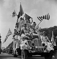 World War II. Liberation of Paris. Victory parade on the Champs-Elysées. Car of the Red Cross. Paris (VIIIth arrondissement), on August 26, 1944. Photograph by Jean Roubier (1896-1981). © Fonds Jean Roubier/Roger-Vio