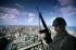 Lebanese civil war. Soldier of the Lebanese army on the top of the Risk tower. Beirut (Lebanon), February 1983. © Françoise Demulder / Roger-Viollet