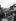 Petit garçon serrant la main d'un chauffeur de bus, monté sur un bus miniature. Londres (Angleterre), 15 avril 1935. © Barratts/PA Archive/Roger-Viollet