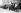 Sapeurs-pompiers partant pour le feu. Caserne de la rue Haxo. Paris (XXème arr.).  © Neurdein/Roger-Viollet