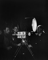 "Jean Renoir (on the right), during the shooting of ""Madame Bovary"", in 1933.    © Boris Lipnitzki / Roger-Viollet"
