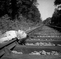 Boy miming a suicide on a railroad track. Photograph by Gaston Paris (1903-1964). France, circa 1945-1946 © Gaston Paris / Roger-Viollet