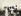 Gustav Klimt (1862-1918), peintre autrichien, à table avec ses amis (de g. à dr. :  Hannerl Groegl, X, Emilie Floege, X, Emma Bacher, Helene Klimt, Heinrich Boehler, Klimt se tenant à l'arrière-plan), lors d'une excursion au Gahberg, au lac Attersee (Autriche). Photographie, 1908. © Imagno / Roger-Viollet