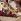 Femme, cigarette à la main, prenant un bain de soleil à la plage. France, années 1950-1960. © Roger-Viollet