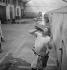 Butcher drinking at the Vaugirard slaughterhouse. Paris, 1950. © Gaston Paris / Roger-Viollet
